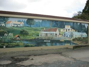 The Landing with original store top right, Maori whare bottom left
