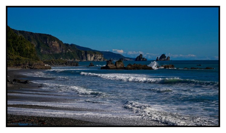 Great Coast Road with crashing seas and Motukieikie rocks and Mt Cook in distance