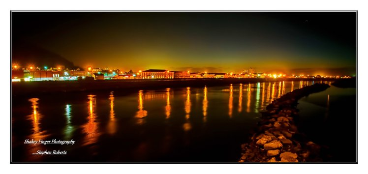 Evening lights on Grey River with Greymouth township lights
